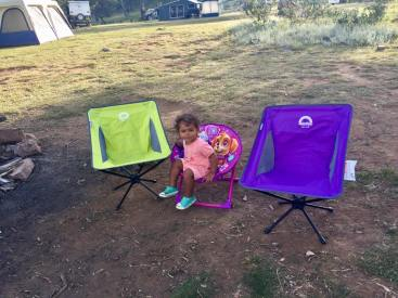 Someone enjoying their new camping chair