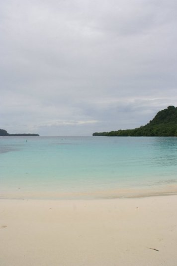 I wont forget this beach. It was raining and the water was so calm and blue. Was such a great feeling swimming here under the rain drops.