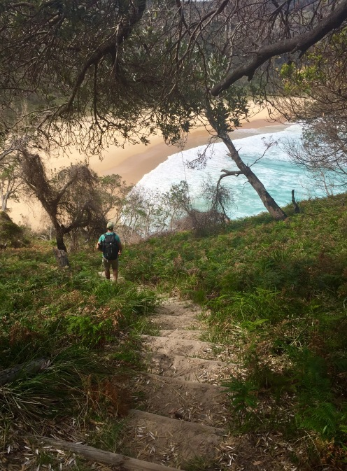 Climbing some steep steps to the secluded beach
